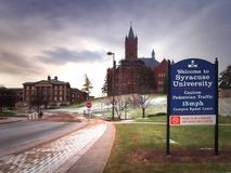 SU welcoming sign. Syracuse, New York, USA. January 27, 2018. Welcoming sign to the Syracuse University campus on Crouse Drive with Maxwell Hall and Crouse royalty free stock photo