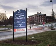 SU welcoming sign. Syracuse, New York, USA. January 27, 2018. Welcoming sign to the Syracuse University campus on Crouse Drive with Maxwell Hall in the distance stock photo