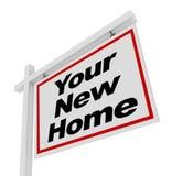 Sua casa nova para a casa de Real Estate do sinal da venda Foto de Stock Royalty Free