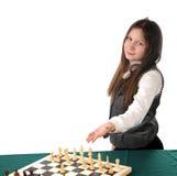 Sua volta. Menina que convida para jogar a xadrez Foto de Stock Royalty Free