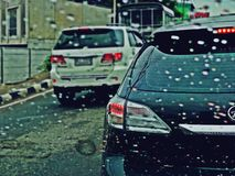 Suan Luang, THAILAND - 10 november 2018 : Traffic in rainy day on the road and rain drops on car window with tailing break light. royalty free stock photo