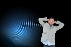 Suave man in a blazer with hands behind head looking at camera Stock Photography