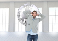 Suave man in a blazer with hands behind head looking at camera Royalty Free Stock Photo