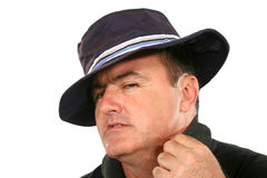 Suave Man In Hat. Man in hat with a suave and cool look Royalty Free Stock Photography