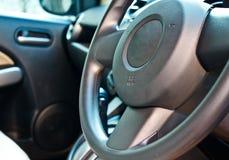 Sub compact car steering wheel. Closeup of sub compact car steering wheel, modern style Royalty Free Stock Photo