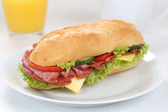 Sub deli sandwich baguette for breakfast with salami ham and ora Stock Photos