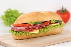 Sub deli sandwich baguette with salami ham for breakfast Royalty Free Stock Photo