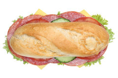 Sub deli sandwich baguette with salami top view isolated Stock Images
