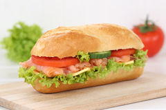 Sub deli sandwich baguette with salmon fish for breakfast Royalty Free Stock Image