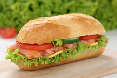 Sub deli sandwich baguette with salmon fish Stock Photos