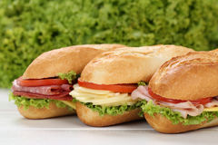 Sub deli sandwiches baguettes with ham, salami and cheese Stock Photo