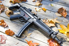 Sub machine gun in the fall. Picture of a sub machine gun surrounded by leaves Stock Images