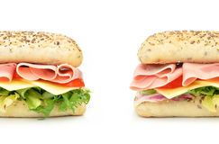 Sub sandwich. Baguette ends with ham and cheese Stock Images