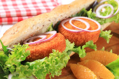 Sub sandwich. With fried patties and lettuce Stock Photography