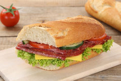 Sub sandwich baguette with salami ham for breakfast Stock Photography