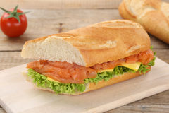 Sub sandwich baguette with salmon fish for breakfast Stock Images