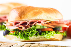 Sub sandwich. With fresh vegetables, lunch meat and cheese on hoagie roll Royalty Free Stock Photo