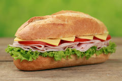 Sub Sandwich with ham. Sub Sandwiches with ham, cheese, tomatoes and lettuce Stock Photography