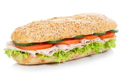 Sub sandwich with ham whole grains grain baguette isolated on white. Sub sandwich with ham whole grains grain baguette isolated on a white background royalty free stock images