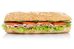 Sub sandwich with ham whole grains grain baguette lateral isolated on white. Sub sandwich with ham whole grains grain baguette lateral isolated on a white stock image