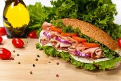 Sub Sandwich. Homemade Italian Sub Sandwich with Salami, Tomato, and Lettuce. Selective focus Stock Photos