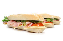 Sub sandwiches. Sub sandwich baguettes filled with ham, cheese and tomatoes Royalty Free Stock Photos