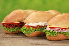 Sub Sandwiches. With pepperoni, ham, salmon, cheese, tomatoes and lettuce stock image