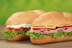 Sub Sandwiches with ham and salmon stock images