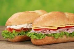 Sub Sandwiches met ham en zalm Stock Afbeeldingen