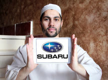 Subaru car logo. Logo of subaru car brand on samsung tablet holded by arab muslim man Stock Photo