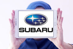 Subaru car logo. Logo of subaru car brand on samsung tablet holded by arab muslim woman Stock Image
