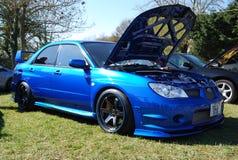 Subaru fast. Modified alloys wheels blue race royalty free stock image