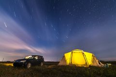 Subaru Forester at beach camping under stars. Subaru Forester at beach camping under night sky royalty free stock photography