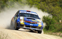 Subaru Impreza STI N14 rally Car. Gavino Carta of  Italy  with  Andrea Segir (co-pilote) drives his  Subaru Impreza STI N14 during the sixth stage of the 2010 Stock Photography