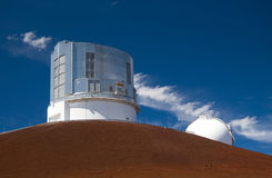 Subaru Observatory. The Subaru Observatory atop the Mauna Kea volcano in Hawaii Big Island. Part of the Keck Observatory is also visible Stock Photography