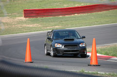 Subaru STi driving on Race Course. A Subaru STi sports car driving on a race course. See my portfolio for more automotive images stock photography