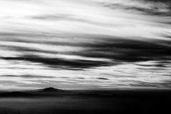 Subasio Mt. Umbria, Italy, with sky covered by clouds and mist on the valley underneath.  Royalty Free Stock Images