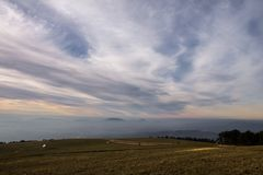 Subasio Mt. Umbria, Italy, with sky covered by clouds and warm sunset colors.  Stock Images