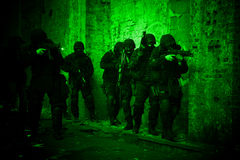 Subdivision anti-terrorist police. During a black tactical exercises in Poland. Entry to the premises. Real situation. View through the night vision device Stock Images