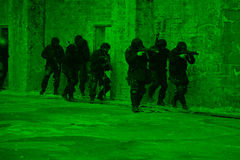 Subdivision anti-terrorist police. Subdivision anti-terrorist police during a black tactical exercises. Entry to the premises. Real situation. View through the Stock Photography