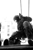 Subdivision anti-terrorist police. Subdivision anti-terrorist police during a black tactical exercises. Rope Techniques.  Real situation. Black and white photo Royalty Free Stock Images