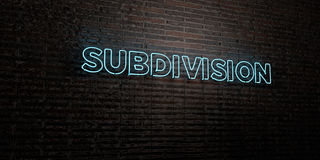 SUBDIVISION -Realistic Neon Sign on Brick Wall background - 3D rendered royalty free stock image Stock Photos