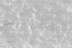 Monochrome uneven brick structure texture for background. Subdued contrast in this uneven brick background should fit into a slide presentation perfectly Royalty Free Stock Photo
