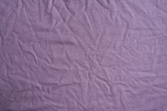 Subdued pink viscose fabric with folds. From above Stock Image