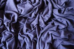 Subdued violet blue stockinet fabric in folds. Subdued violet blue stockinette fabric in folds Royalty Free Stock Images