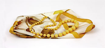 Subdued Yellow Necklace on Floral Scarf Stock Image