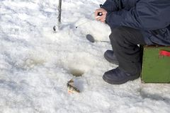 Subglacial fishing in the winter Stock Photography