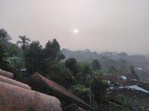 Subida de Sun en el tejado Fotos de archivo