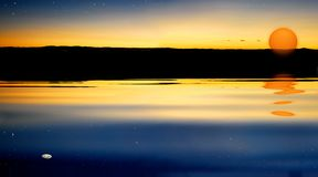 Subida y estrella de la luna de la puesta del sol Foto de archivo