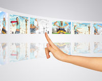 Subject construction. Finger presses one of Stock Photography